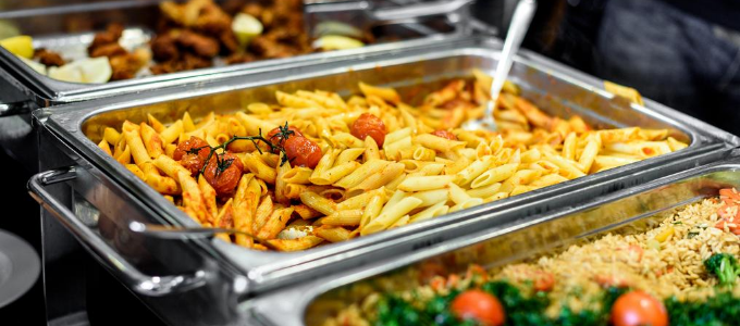 A photo of food being served buffet style.